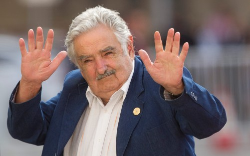 Uruguay's president Jose Mujica waves at the press upon his arrival at La Moneda presidential palace in Santiago, on March 10, 2014.